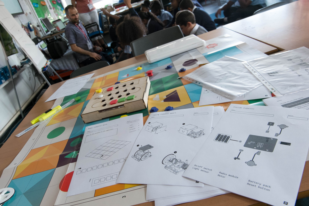 cubetto interface board, adventure world map, and diy manual guide inside school classroom