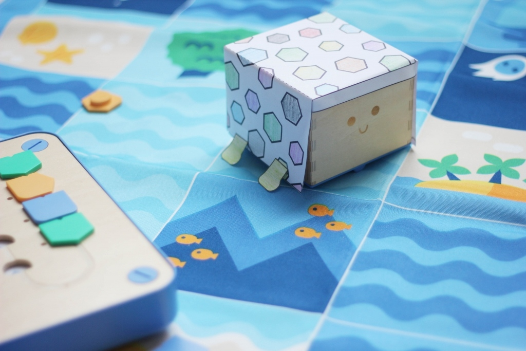 wooden friendly robot for kids 3-6 cubetto dressed animal on ocean adventure map