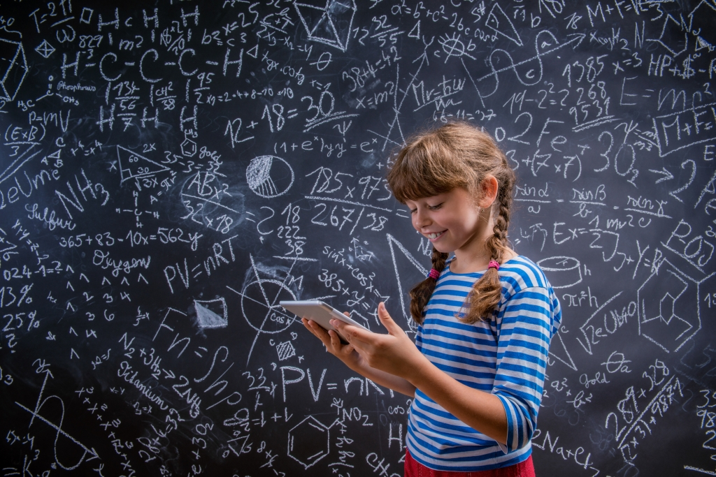 girl with tablet in front of big blackboard, kids education