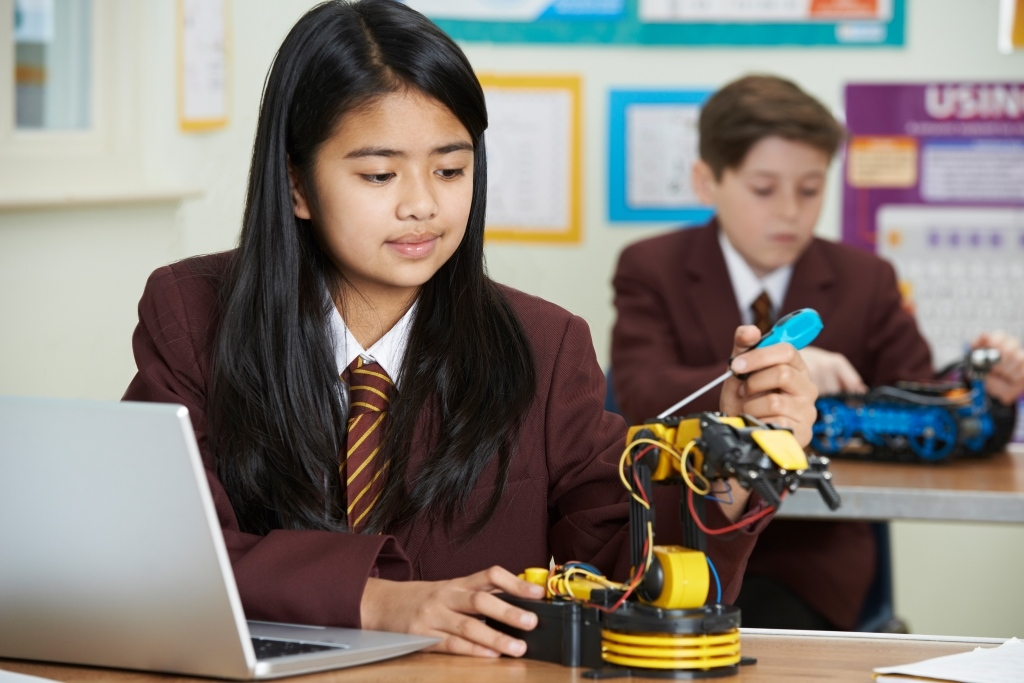 Pupils In Science Lesson Studying Robotics, teach kids to code
