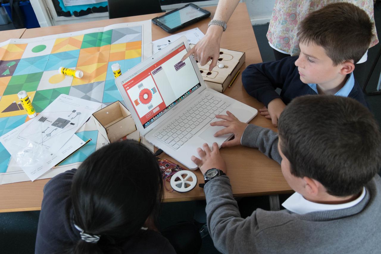 kids on laptop in school