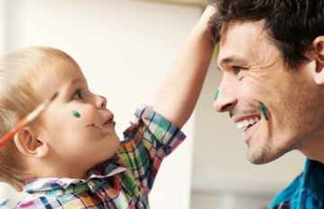 profile shot of toddler playing with father