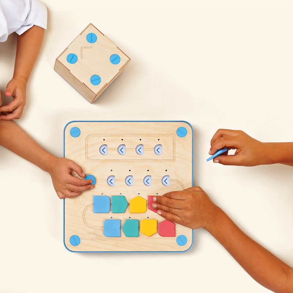 kids playing with cubetto interface board