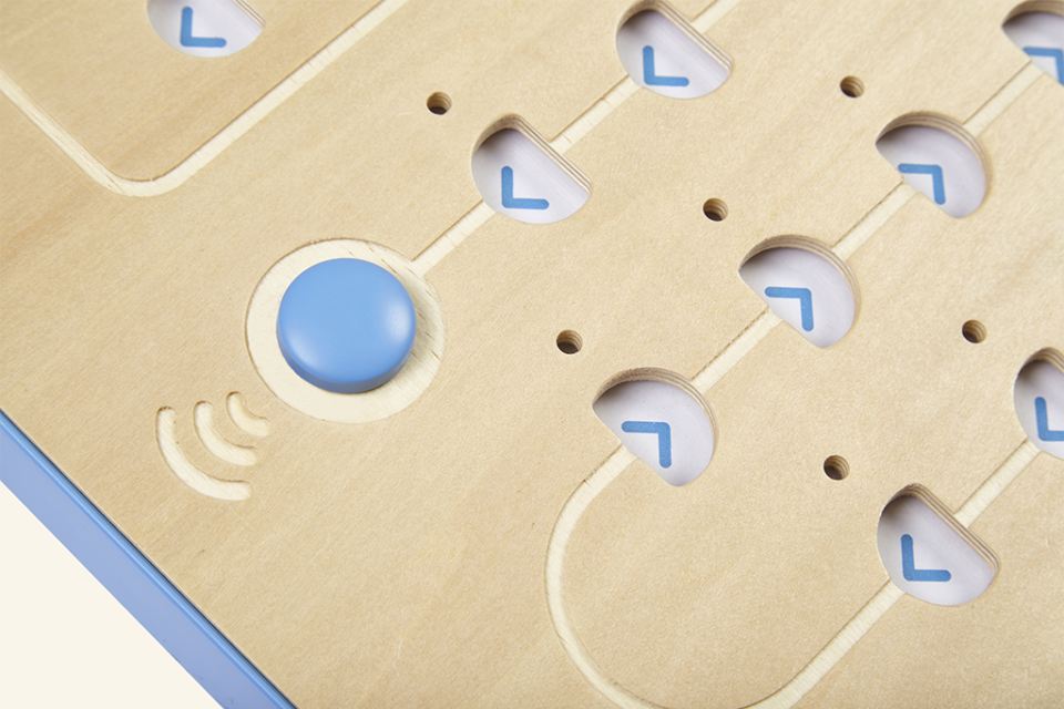 close up photograph of the go button on cubetto interface board