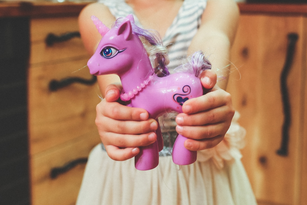 pink toy unicorn, child, best toddler toys, best educational toys for girls
