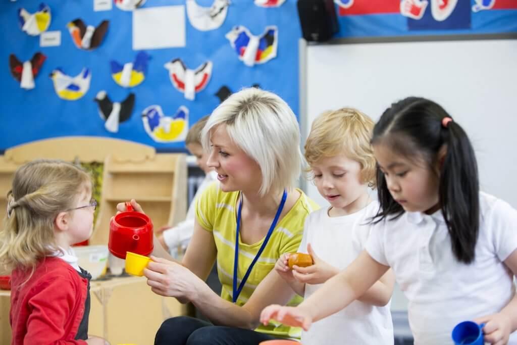 Kindergarten teacher and class